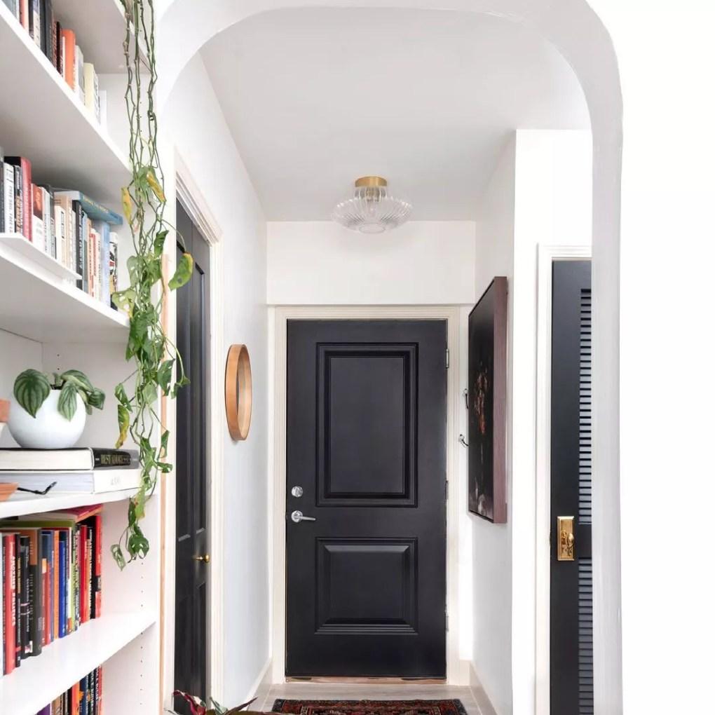 Entryway with a black door
