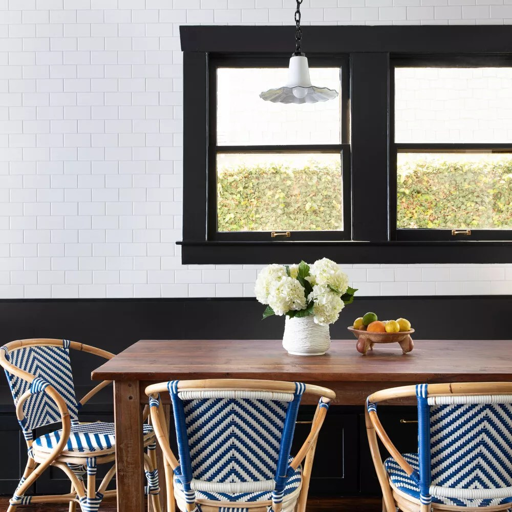 A dining room surrounded by bold woven chairs