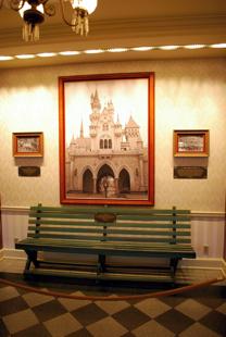 Griffith_Park_Bench_&_Walt_Walking_through_Castle-Disneyland Mobile Guide