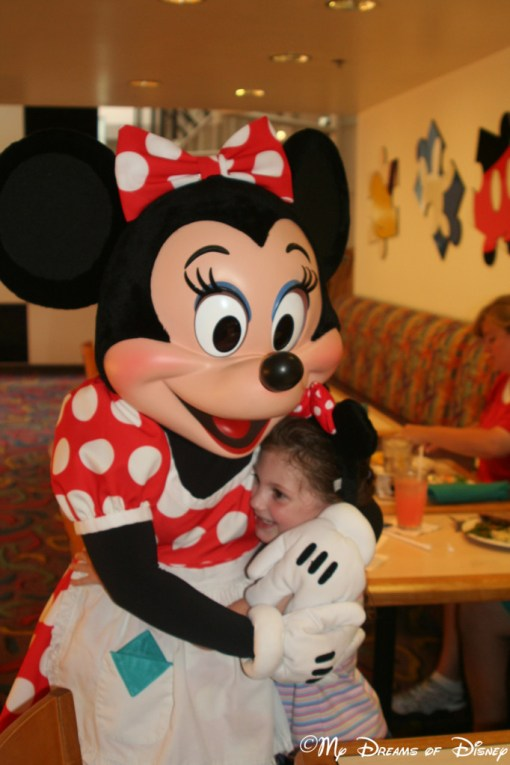 Sophie and Minnie hugging it out at Chef Mickey's!