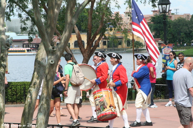 The Fife and Drum Corp marching into position to perform at the American Adventure Pavilion