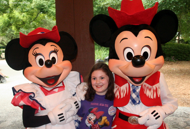 Sophie poses for a picture with Mickey & Minnie at the Backyard BBQ! Note the shirt Sophie made!