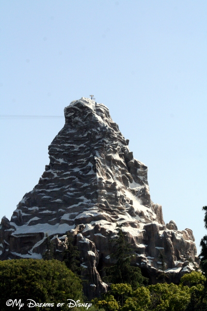 The Matterhorn Bobsleds tower over you at Fantasyland.