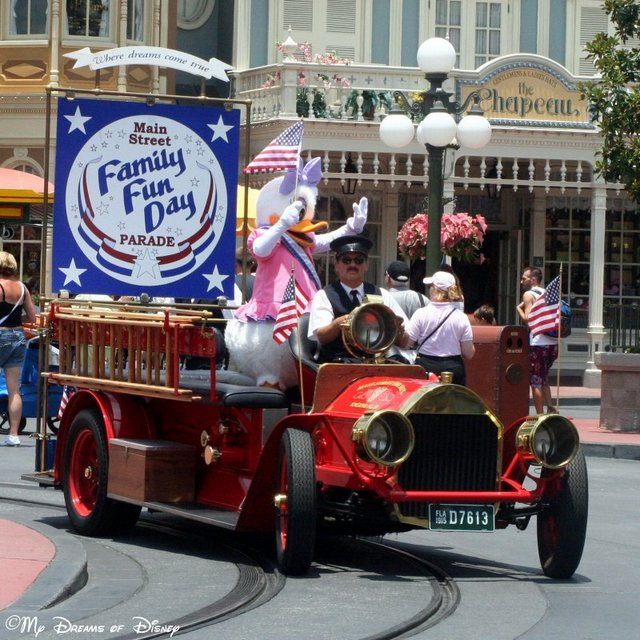 Daisy rides tall on top of the Fire Engine in the Disney Family Fun Day Parade!