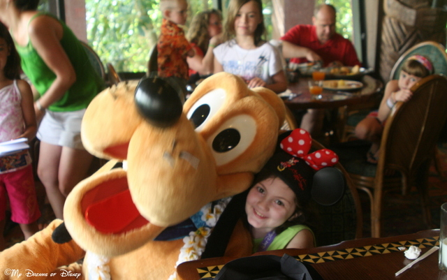 Pluto hams it up for the camera as Sophie leans in for a big hug!