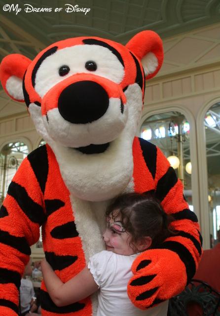 Sophie giving a Bear Hug -- or a Tigger Hug -- to Tigger!