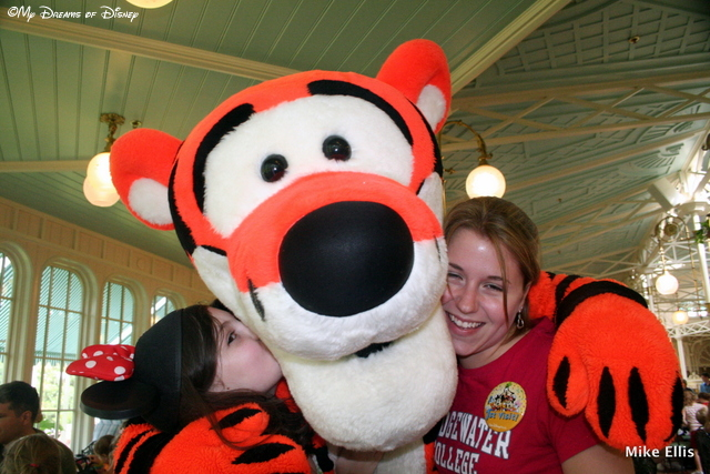 Sophie, Tigger, and Stephanie squeezing a hug!  Look at what a camera hog Tigger is!