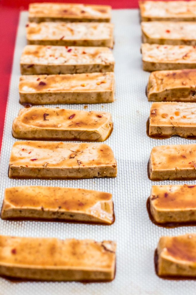 Picture of marinated tofu on the baking sheet before baking in the oven