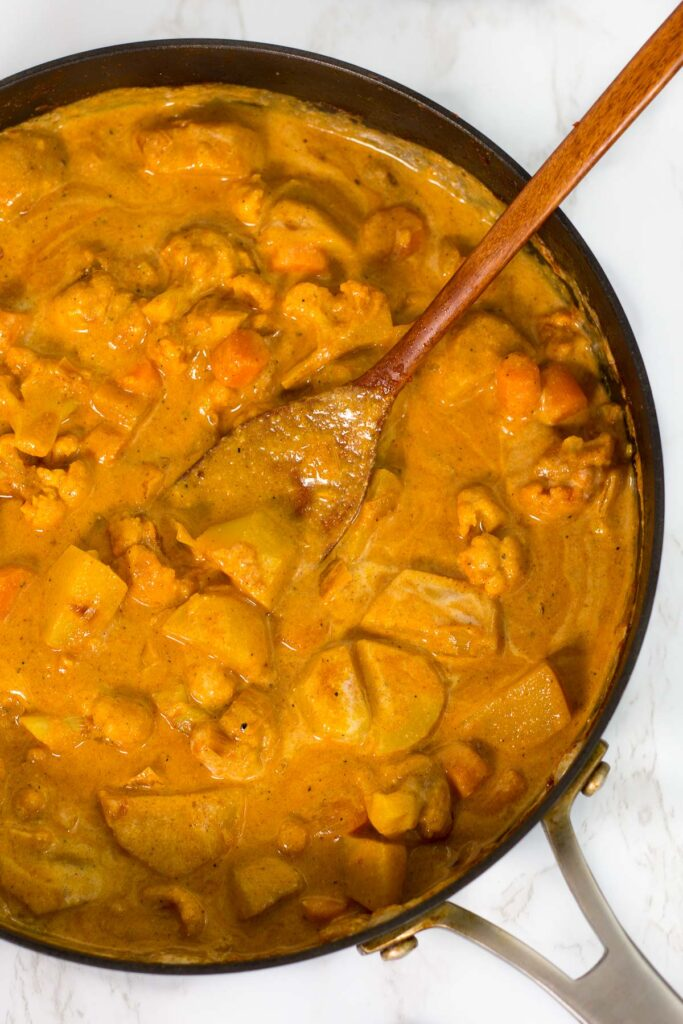 veggie curry in the pot after adding the cashew cream