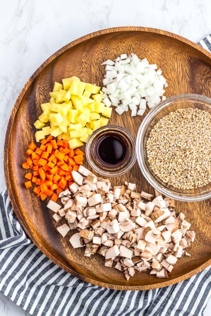 ingredients to make savory oatmeal - steel cut oats, onion, potato, carrot and mushroom