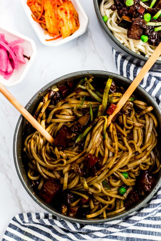 overhead shot of mixed Korean black noodle (Jjajangmyeon)