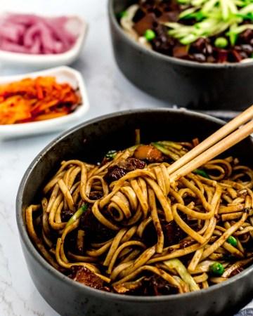 Mixed vegan jjajangmyeon (Korean black bean noodles) in a bowl