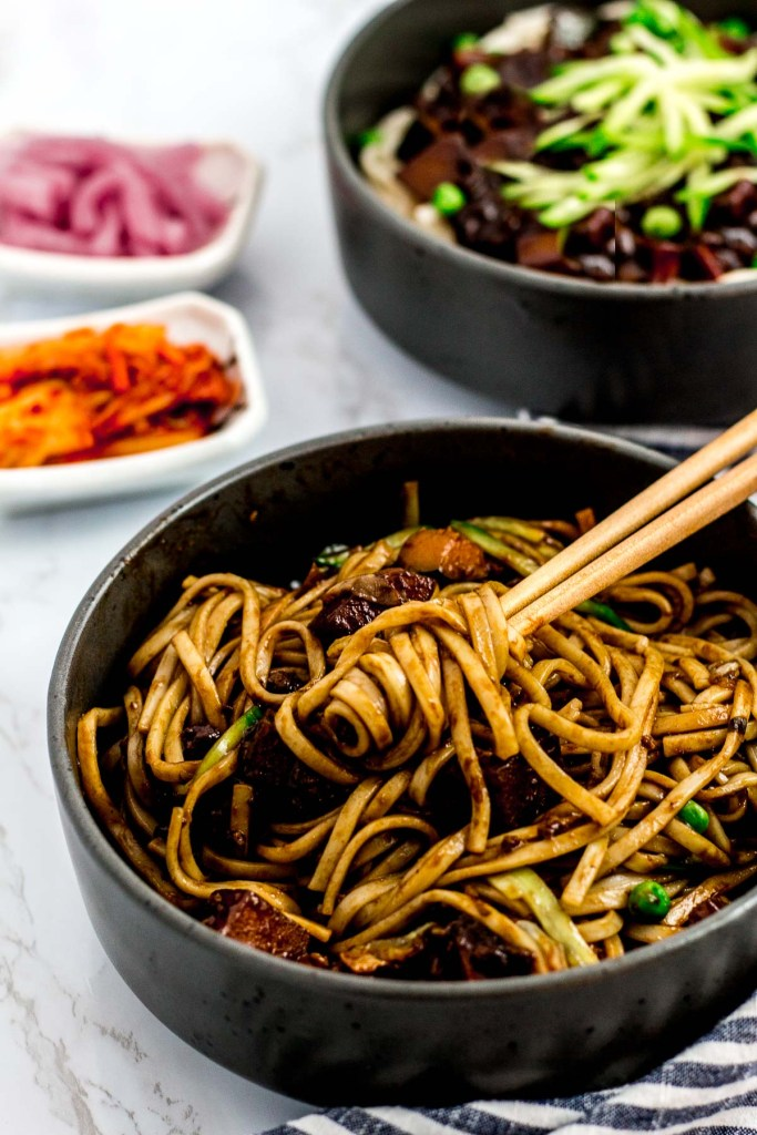 Mixed vegan jjajangmyeon (Korean black bean noodles) in a bowl