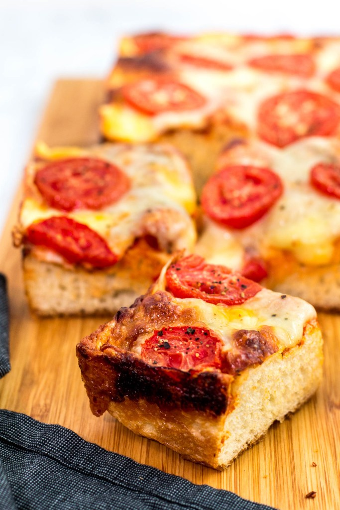 A piece of vegetarian Detroit-style pizza