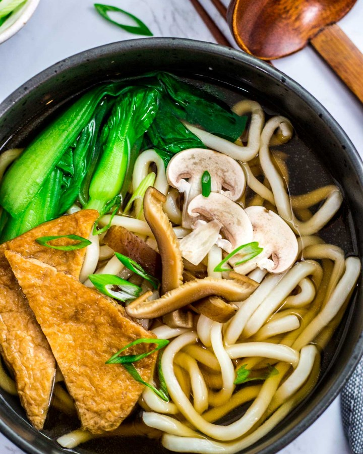 Close up shot of vegan udon noodle soup