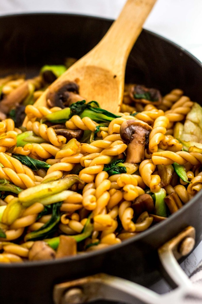 Close up photo of bok choy mushroom pasta stir fry