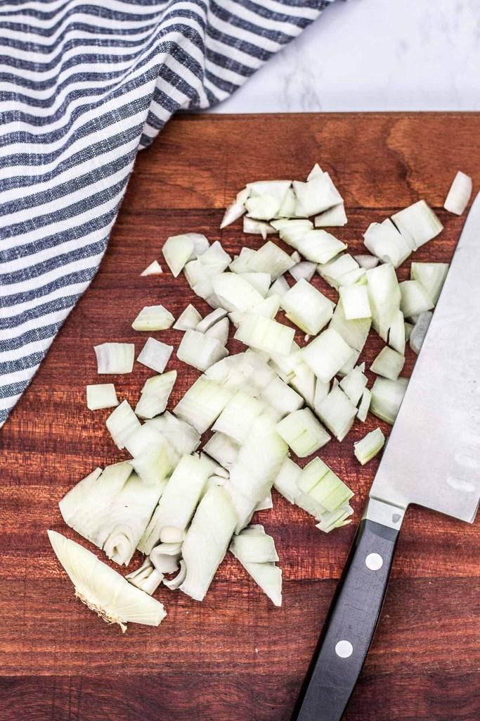 diced onion on a cutting board