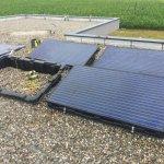 Guide de pose panneaux photovoltaïques : autoconsommation et RT 2012 sur toit plat