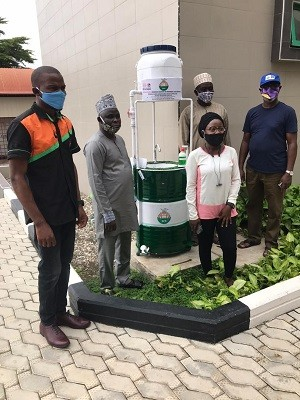 Ikeja Engineers Donate Mobile Handwashing Machine made by its Young Members to NSE Head office
