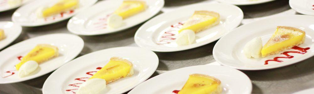 plated lemon tarte au citron in kitchen