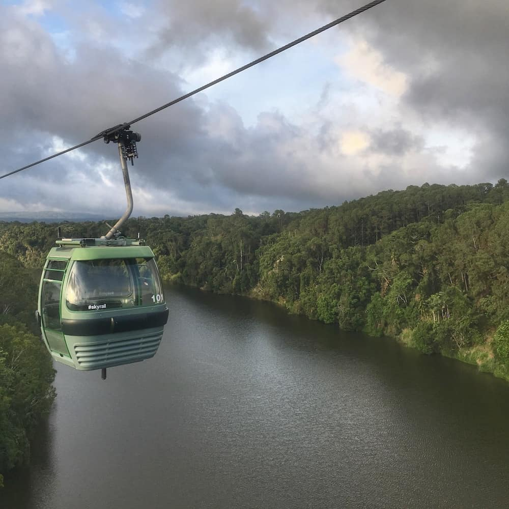 Cable car from Skyrail going over the river and the rainforest near Cairns.