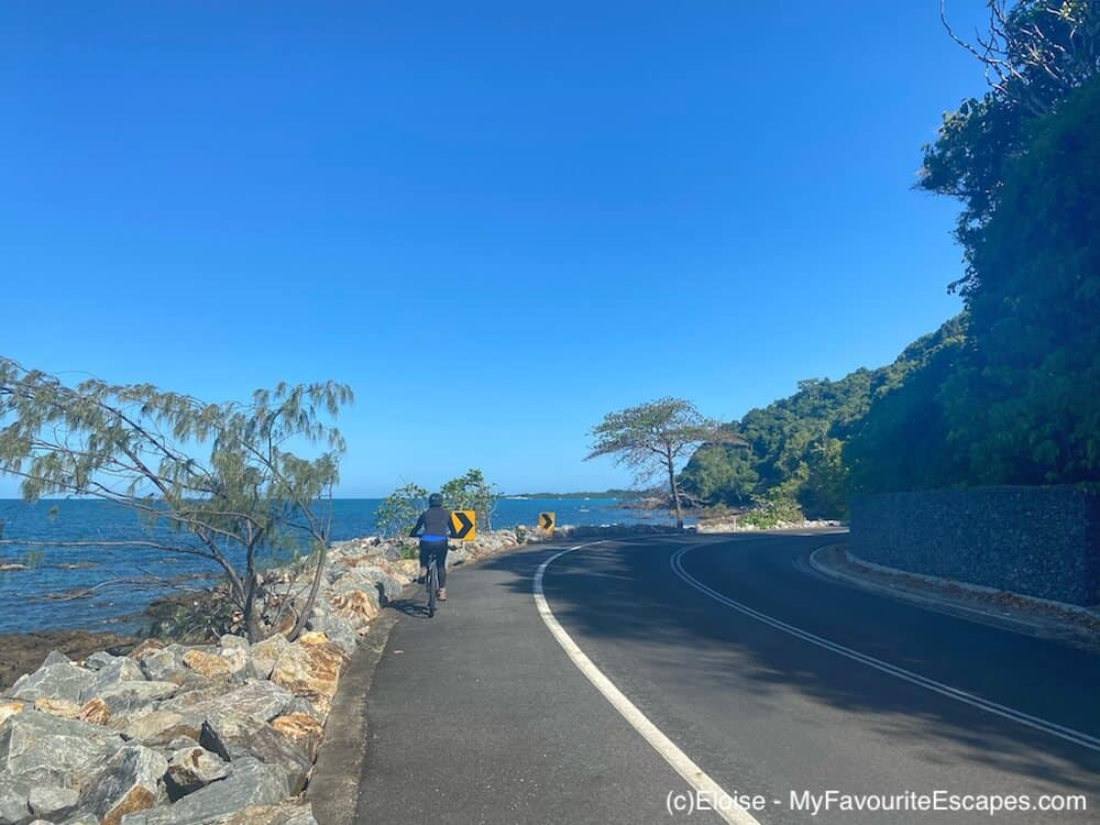 Bike stopped on the road between Mission Beach and Bingil Bay