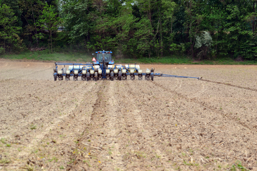 12-row corn planter with guide arm