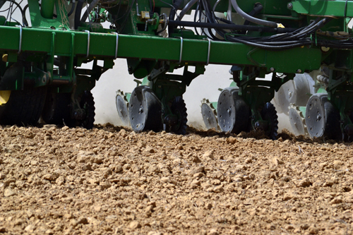 16-row corn planter in action close up