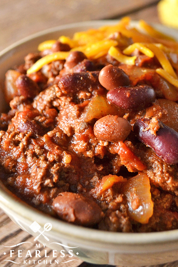 Crockpot Chili from My Fearless Kitchen. Whip up a batch of this Crockpot Chili to welcome in the chilly fall weather! It's so quick to put together, and it smells so great simmering all day long. #beefrecipes #chilirecipes #easyrecipes #groundbeefrecipes