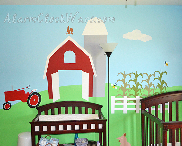 a large barn above the changing table in a farm-themed nursery