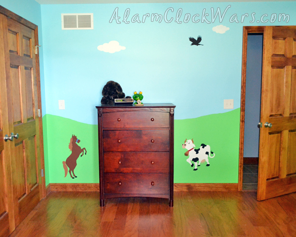 a dairy cow and a horse in a farm-themed nursery