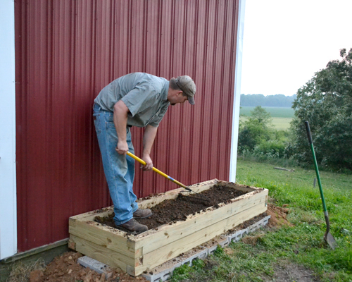 mix and level the dirt in the herb garden