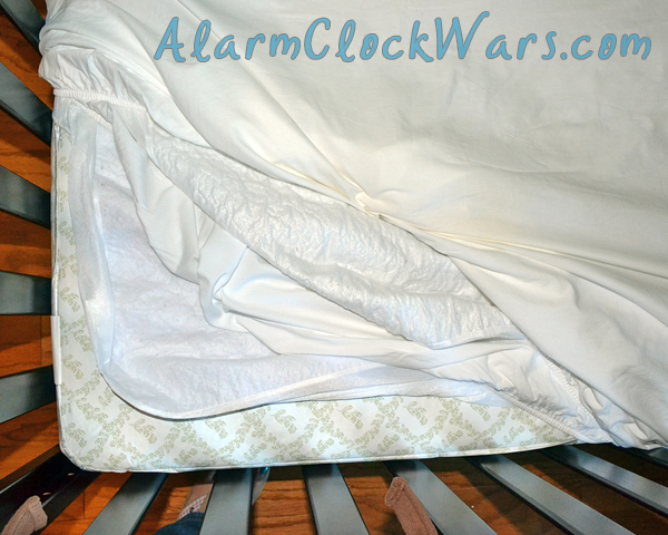 double wrap the crib mattress to make middle of the night changes easier