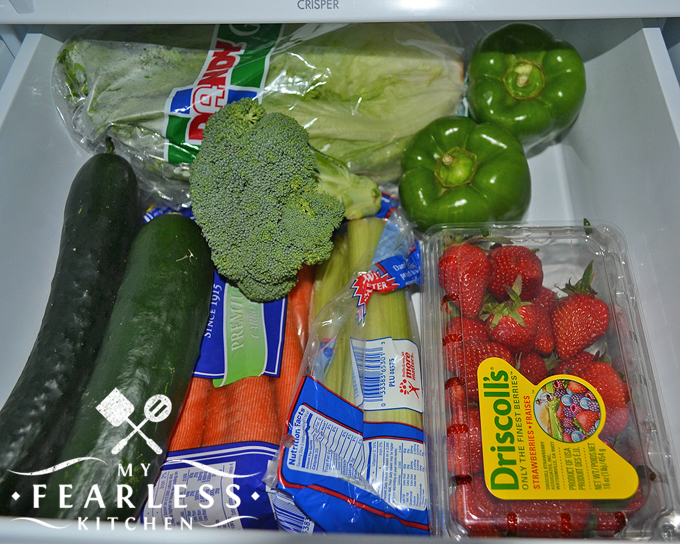 vegetables and berries in the high humidity crisper drawer in a refrigerator