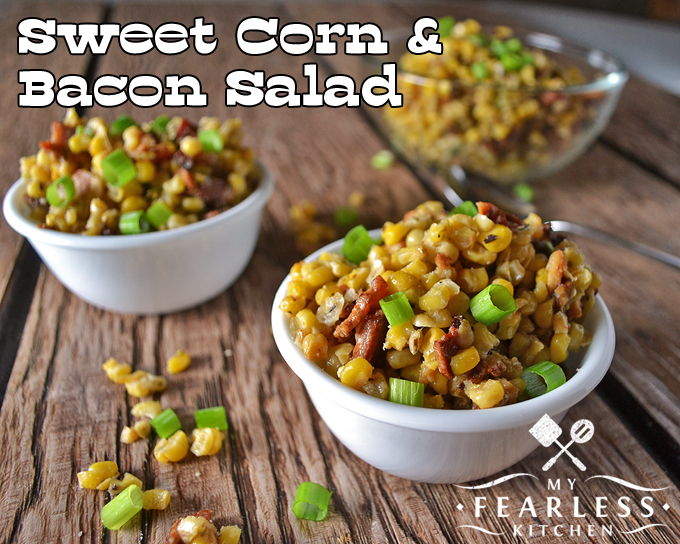 2 bowls of Sweet Corn & Bacon Salad on a wood background
