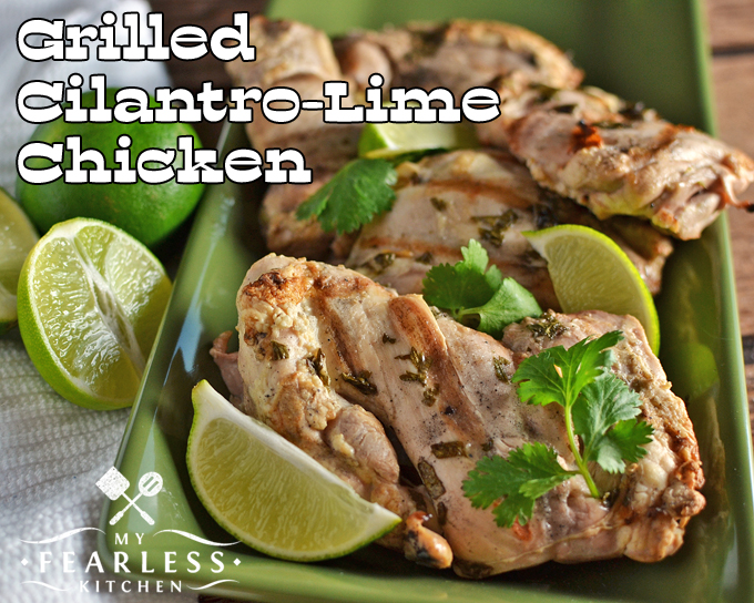 grilled cilantro-lime chicken thighs on a green plate