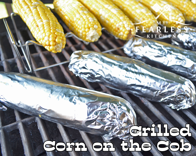sweet corn on the cob wrapped in aluminum foil and sweet corn on the cob on a grilling rack on a grill