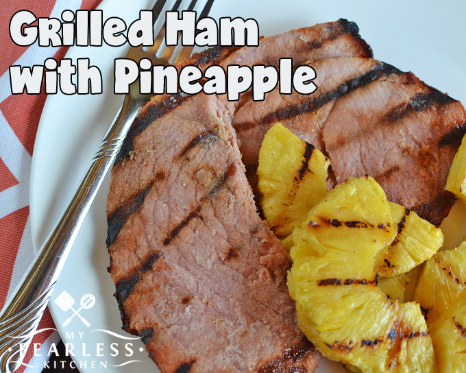 grilled ham steaks with pineapple on a white plate