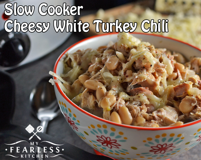 Slow Cooker Cheesy White Turkey Chili from My Fearless Kitchen. Are you looking for some hearty, tasty, comfort food? This Slow Cooker Cheesy White Turkey Chili cooks all day while you relax and enjoy your day!