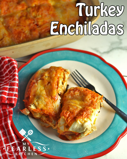 turkey enchiladas on a plate, with more in a casserole dish