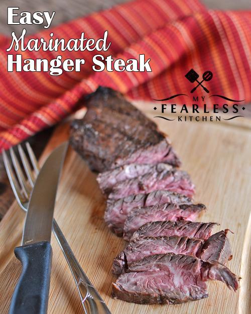 sliced medium-rare Easy Marinated Hanger Steak on a bamboo cutting board