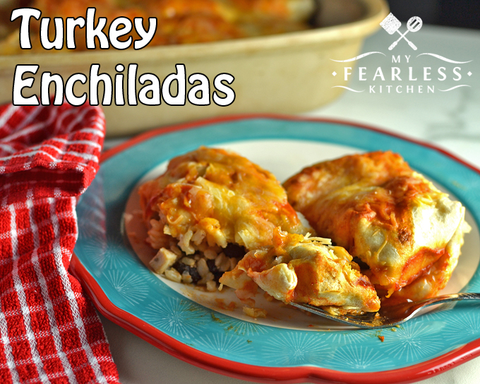 turkey enchiladas on a red, white, and blue plate