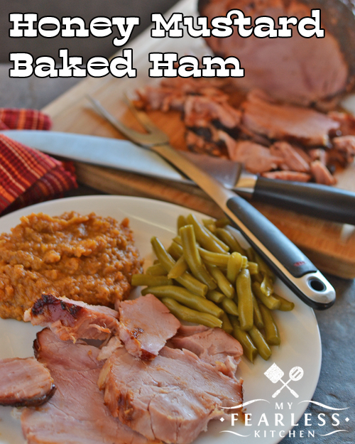 thick slices of Honey Mustard Baked Ham with green beans and mashed sweet potatoes and a boneless ham in the background