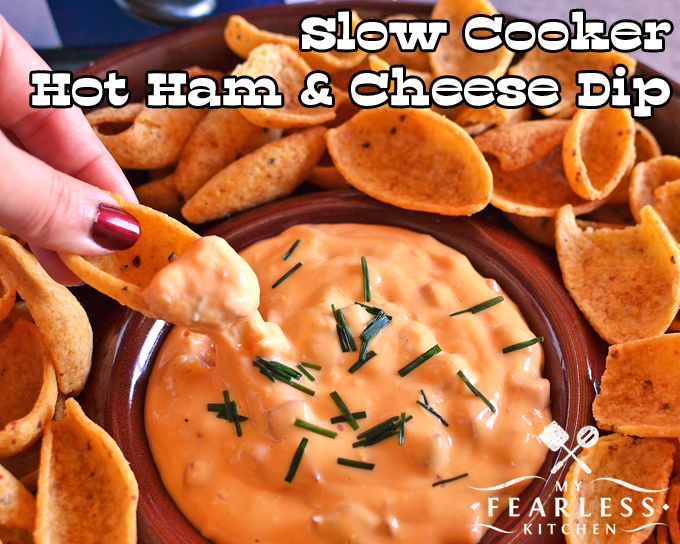 Slow Cooker Hot Ham & Cheese Dip from My Fearless Kitchen. Tailgates and big family parties call for a hearty dip. This Slow Cooker Hot Ham & Cheese Dip is the perfect comfort food to keep you going all day long!