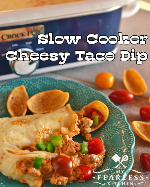 Slow Cooker Cheesy Taco Dip from My Fearless Kitchen. Are you looking for a hearty dip everyone will love? Stock up on chips and make this Slow Cooker Cheesy Taco Dip as an appetizer or the main course!