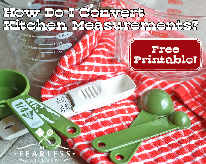 measuring cups and measuring spoons on a red kitchen towel