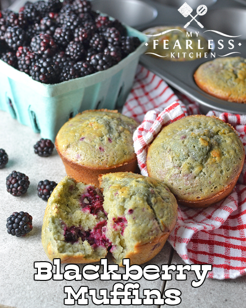 fresh blackberries and Blackberry Muffins with a red and white napkin
