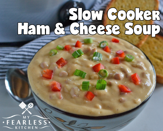 ham and cheese soup topped with diced red pepper and green onion