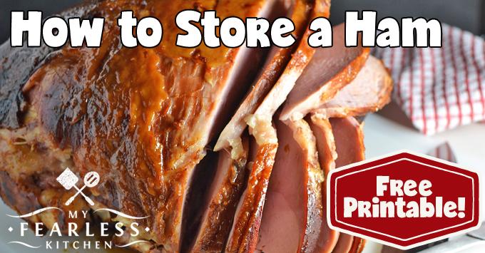 thick-sliced bone-in ham on a white cutting board