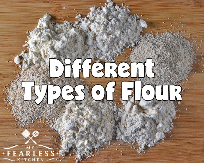 piles of six Different Types of Flour on a wood background